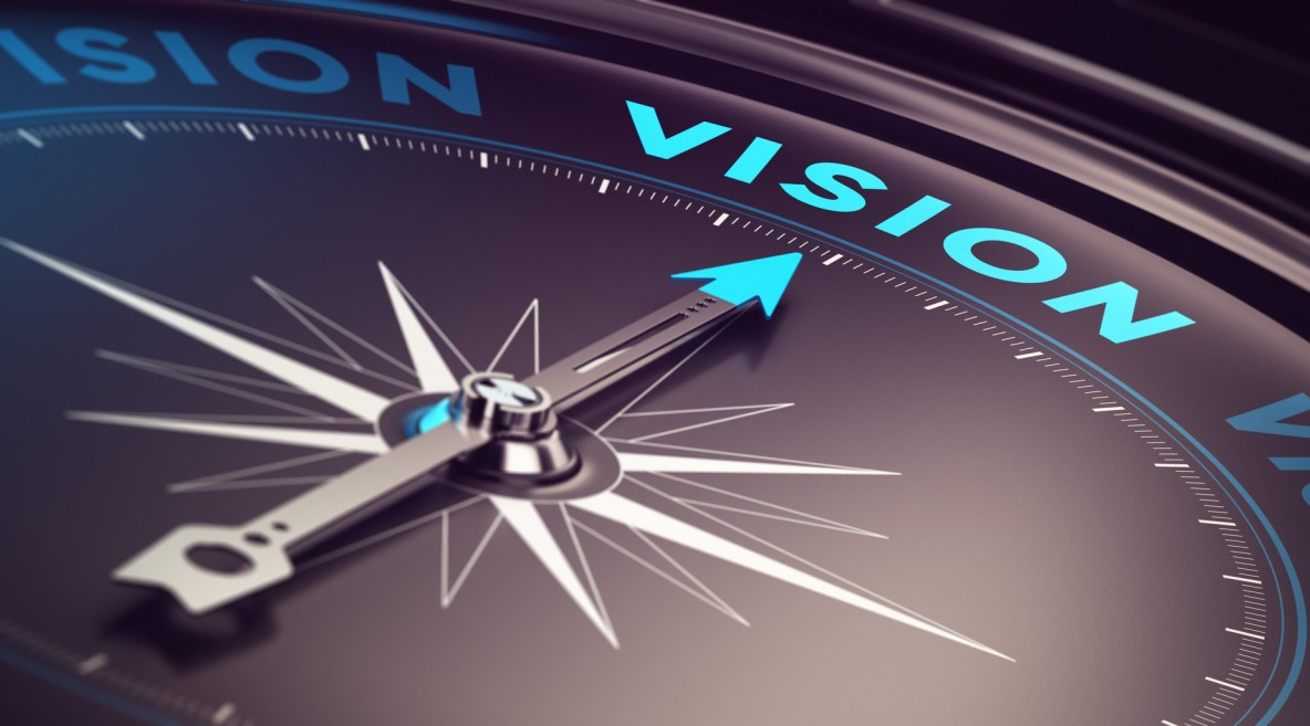 Compass with needle pointing the word vision with blur effect plus blue and black tones. Conceptual image for immustration of company or business anticipation or strategy